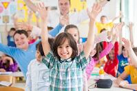 Cheerful group of kids wtih their teacher in school classroom-1