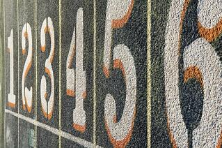 Numbers one through six painted on lanes of weathered track.jpeg