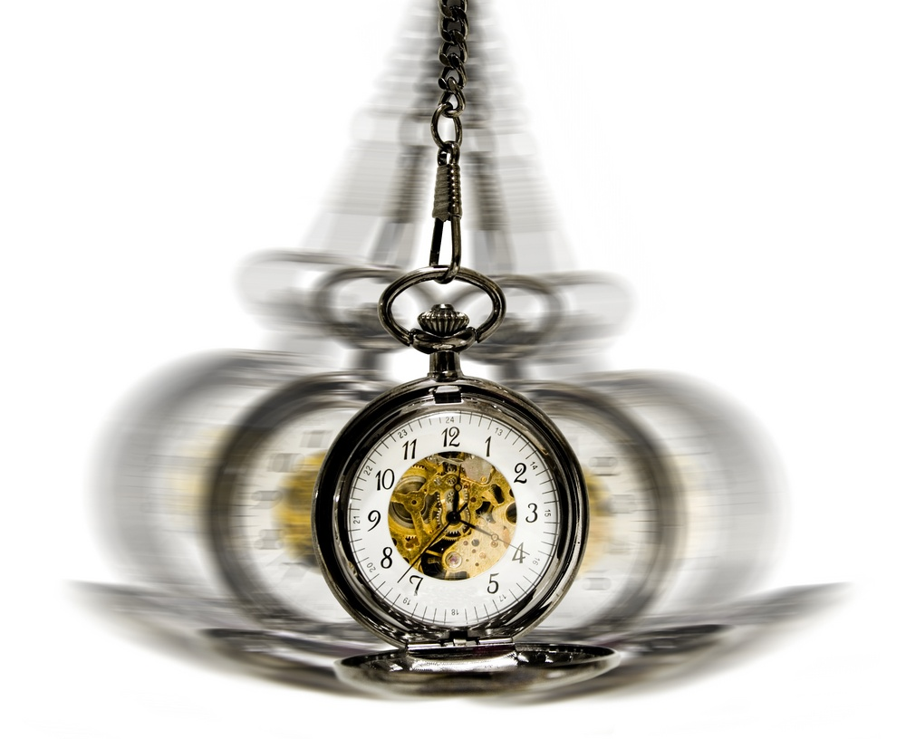 clock in motion over white - hypnotism concept.jpeg